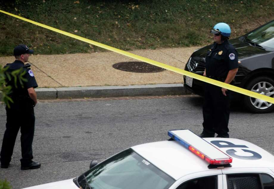 Capitol Hill police on the scene of a shooting on Capitol Hill in Washington Thursday, Oct. 3, 2013. A police officer was reported injured after gunshots at the U.S. Capitol, police said Thursday. They locked down the entire complex, at least temporarily derailing debate over how to end a government shutdown. Photo: AP