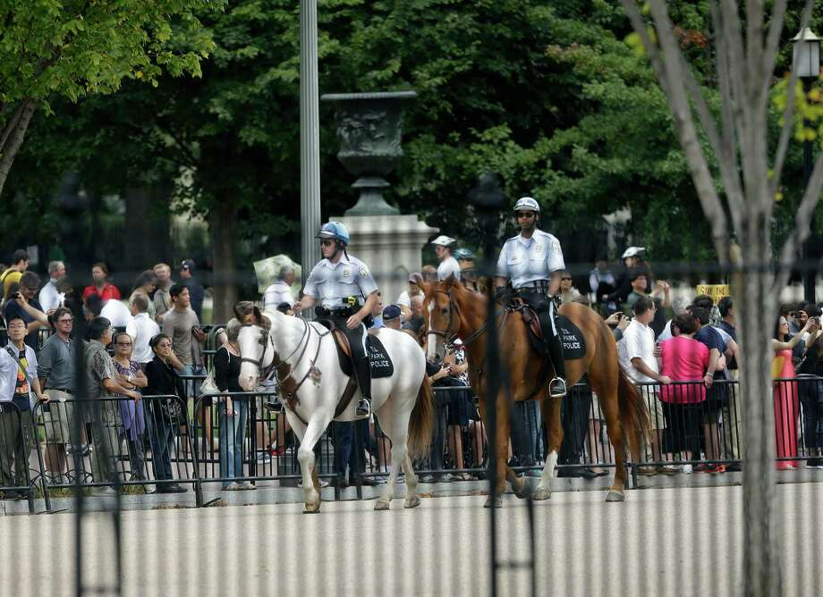 US Park Police police on horseback patrol assist Secret Service during a shutdown Pennsylvania Ave., directly in front of the White House in Washington, Thursday, Oct. 3, 2013, after reports of shots on Capitol Hill. (AP Photo/Pablo Martinez Monsivais) Photo: Associated Press