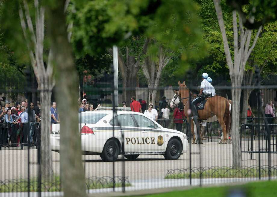 A Secret Service vehicle joins law enforcement officers on horseback from the US Park Police, as they shutdown access n Pennsylvania Ave., directly in front of the White House in Washington, Thursday, Oct. 3, 2013, after a shooting on Capitol Hill.  Police say the U.S. Capitol has been put on a security lockdown amid reports of possible shots fired outside the building. (AP Photo/Pablo Martinez Monsivais) Photo: Associated Press