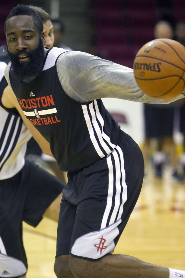 James Harden looks to dribble around his defender during training camp on Thursday at Toyota Center. Photo: Cody Duty, Houston Chronicle