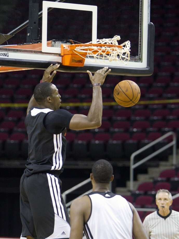 Dwight Howard throws one down. Photo: Cody Duty, Houston Chronicle