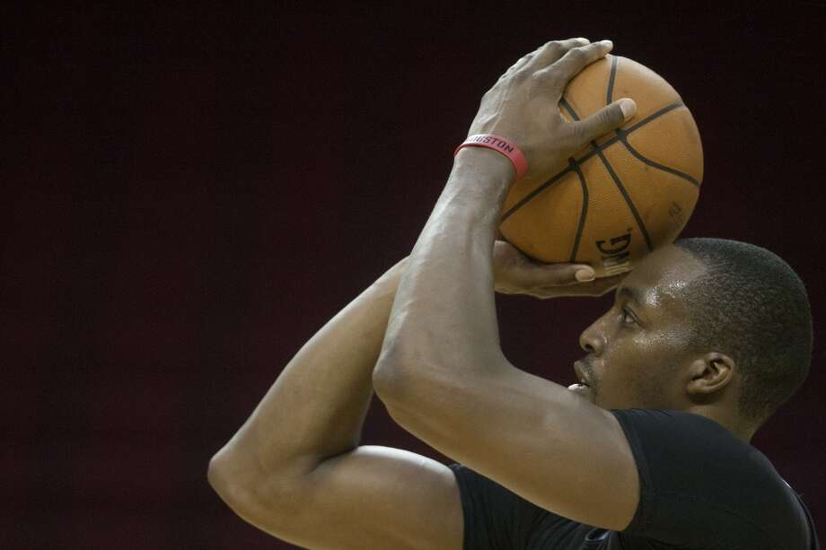 Dwight Howard works on his free throws. Photo: Cody Duty, Houston Chronicle
