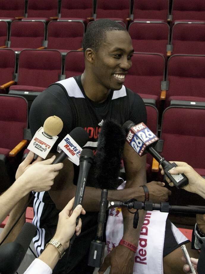 Dwight Howard laughs while talking to reporters after practice. Photo: Cody Duty, Houston Chronicle