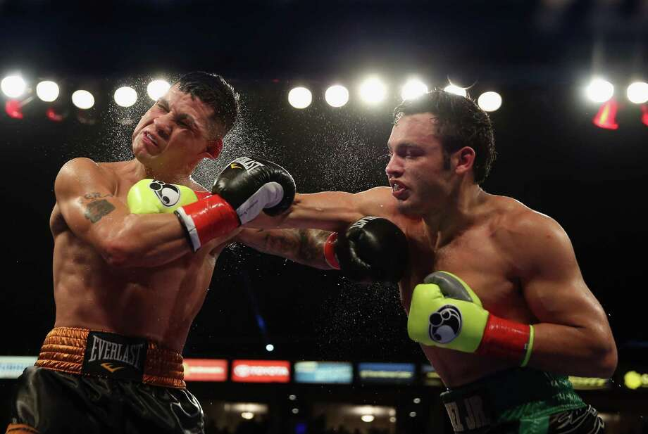 Julio Cesar Chavez Jr. (R) lands a right hand to the head of Brian Vera during their Light Heavyweight bout at StubHub Center on September 28, 2013 in Los Angeles, California. Photo: Jeff Gross, Getty Images / 2013 Getty Images