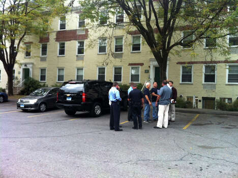 Law enforcement officials gather in the parking lot at Woodside Green Condominiums on Summer Street in Stamford, Conn. as part of the investigation into the shooting in Washington, DC earlier today, Thursday, Oct. 3, 2013. Photo: Maggie Gordon / Stamford Advocate