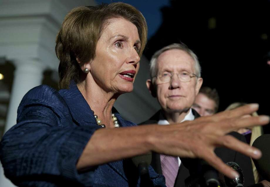 House Democratic Leader Nancy Pelosi and Senate Majority Leader Harry Reid speak following a meeting with President Barack Obama and Speaker John Boehner this week. The Democrats are paying the price for shoving health care reform down Republicans' throats. Photo: SAUL LOEB, AFP/Getty Images / AFP