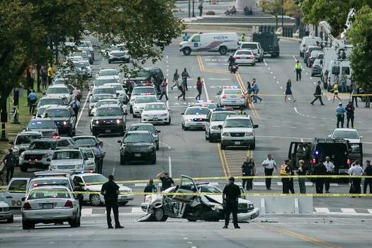 A police car that struck a barricade blocks Constitution Avenue as U.S. Capitol Police investigate a shooting outside of the U.S. Capitol on October 3, 2013 in Washington, DC. Police called the shooting an isolated incident, unassociated with any act of terrorism. Photo: T.J. Kirkpatrick/Getty Images / 2013 Getty Images  Stamford Advocate contributed
