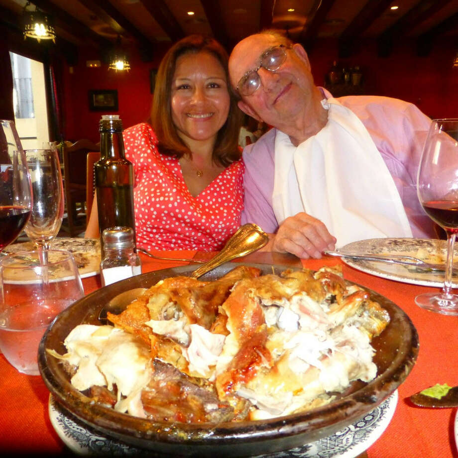 Left: Yanet Castro and Bill Stone of Barcelona, formerly of San Antonio, enjoy a feast at one of their favorite Barcelona restaurants, El Asador de Aranda. Photo: Photos By Nancy Cook-Monroe / For The Express-News