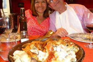 Left: Yanet Castro and Bill Stone of Barcelona, formerly of San Antonio, enjoy a feast at one of their favorite Barcelona restaurants, El Asador de Aranda.