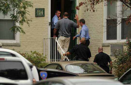 Local and federal authorities search a condominium at 114 Woodside Green in Stamford, Conn. related to a woman's attempt to ram the White House gate today in Washington, D.C. Photo: Jason Rearick