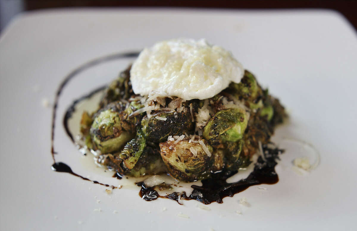 A poached egg adds depth to the Brussels sprouts.