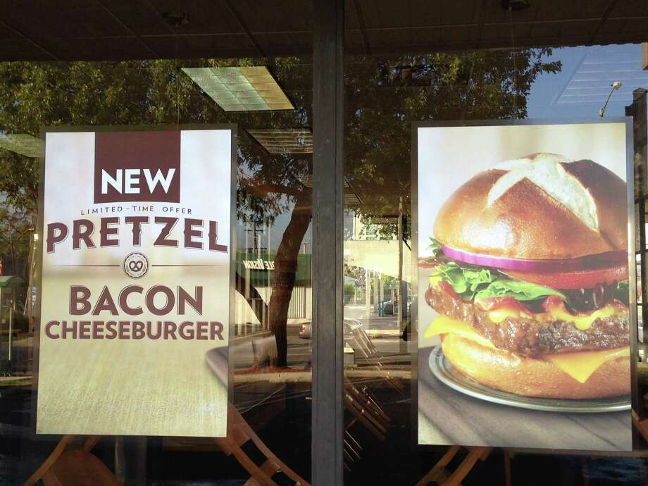 Not your father's pretzel: A sign at Wendy's touts its  pretzel bacon cheese-burger. The fast-food industry has climbed aboard the pretzel bandwagon.