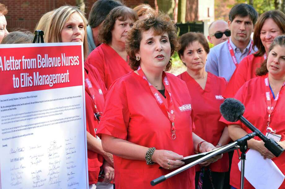 Vickie Decker, a registered nurse for 24 years at Bellevue Hospital, center, speaks during a demonstration by Bellevue nurses who are looking to unionize Thursday, Oct. 3, 2013, outside Ellis Hospital in Schenectady, N.Y.    (John Carl D'Annibale / Times Union) Photo: John Carl D'Annibale / 00024112A