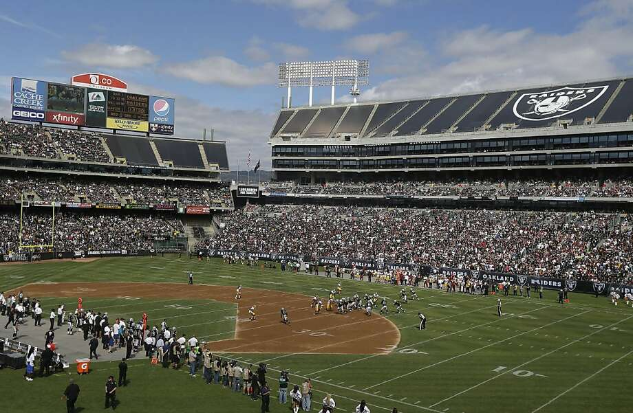 The infield dirt at O.co Coliseum is in the back of NFL players' minds and will be as long as the A's are in the playoffs. Photo: Marcio Jose Sanchez, Associated Press