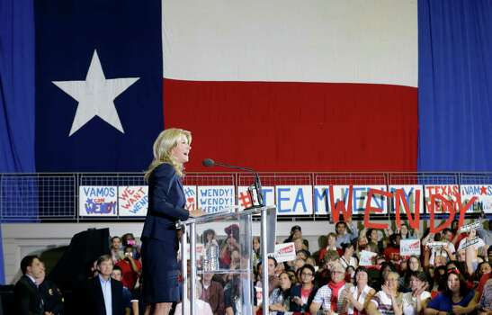 State Sen. Wendy Davis, D-Fort Worth, speaks to supporters at a rally Thursday, Oct. 3, 2013, in Haltom City, Texas, where she formally declared her candidacy for governor of Texas.  (AP Photo/LM Otero) Photo: LM Otero, Associated Press / AP