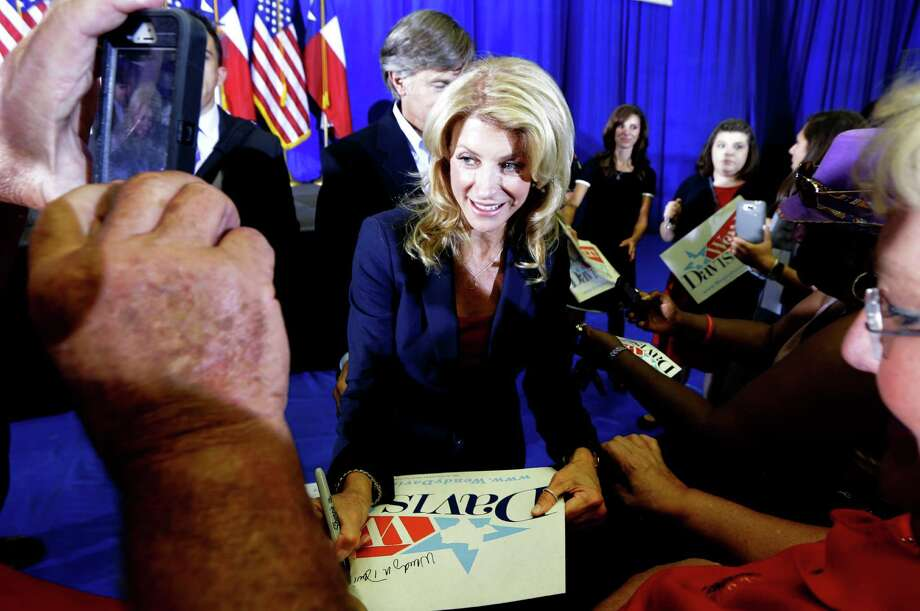 Sen. Wendy Davis, D-Fort Worth, signs autographs and poses for photos for supporter after a rally Thursday, Oct. 3, 2013, in Haltom City, Texas.  Davis formally announced her campaign to run for Texas governor Thursday. (AP Photo/LM Otero) Photo: LM Otero, Associated Press / AP