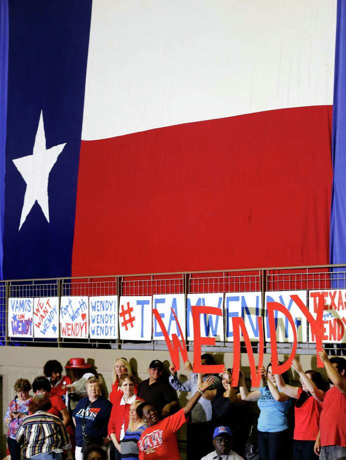 Senator Wendy Davis supporters hold up letters spelling her name inside W.G. Thomas Coliseum in Haltom City, TX, where she is to announce her candidacy for Texas Governor, Oct. 3, 2013. Photo: Bob Owen, San Antonio Express-News / ©2013 San Antonio Express-News