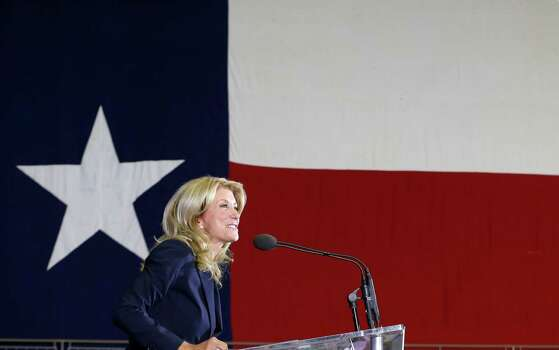 Sen. Wendy Davis, D-Fort Worth, speaks to supporter at a rally Thursday, Oct. 3, 2013, in Haltom City, Texas.  Davis formally announced her campaign to run for Texas governor Thursday. (AP Photo/LM Otero) Photo: LM Otero, Associated Press / AP