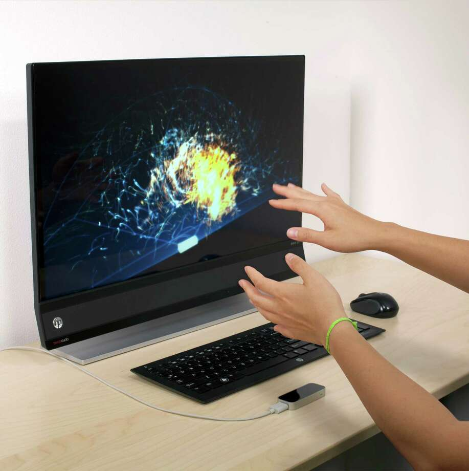 The Leap Motion Controller (pictured at the bottom of the image below the keyboard) offers 3-D motion control for Mac and PC computers using hand and finger movements. Photo: Leap Motion