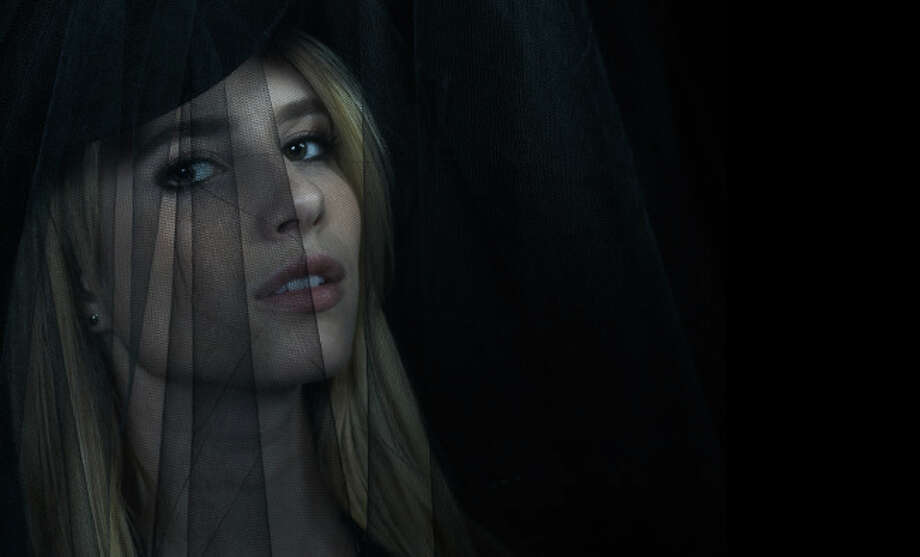 AMERICAN HORROR STORY: COVEN -- Pictured: Emma Roberts as Madison -- CR: Frank Ockenfels/FX