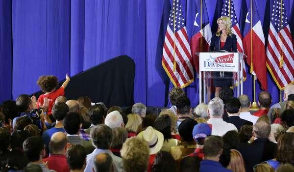 A young fan gives Senator Wendy Davis a thumbs up as she announces her candidacy for Texas Governor at W.G. Thomas Coliseum in Haltom City, TX, Oct. 3, 2013. Photo: Bob Owen, San Antonio Express-News / ©2013 San Antonio Express-News