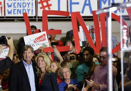 Senator Wendy Davis poses with friend, former Mayor of Austin Will Wynn after she announced her candidacy for Texas Governor at W.G. Thomas Coliseum in Haltom City, TX, Oct. 3, 2013. Photo: Bob Owen, San Antonio Express-News / ©2013 San Antonio Express-News