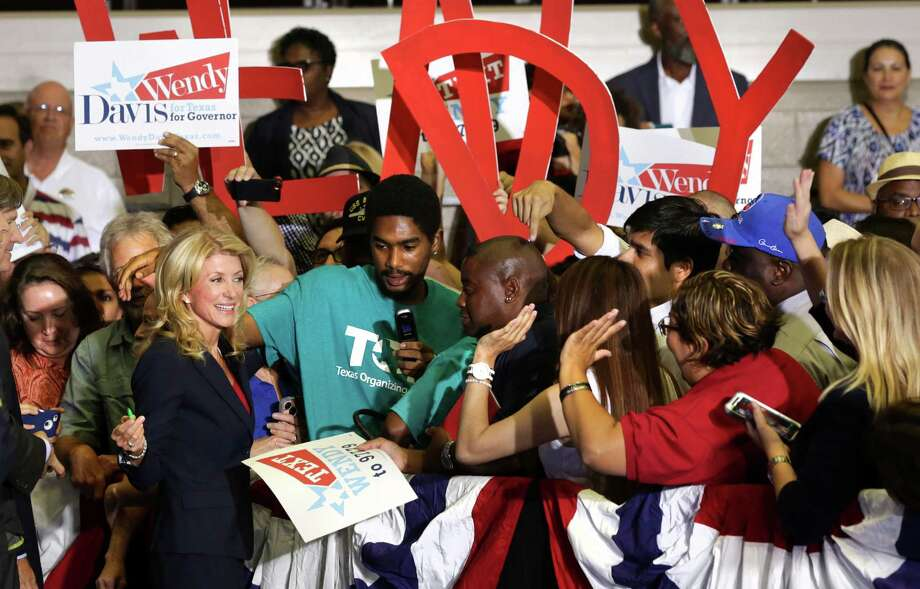 Senator Wendy Davis greets the crowd of supporters after she announced her candidacy for Texas Governor at W.G. Thomas Coliseum in Haltom City, TX, Oct. 3, 2013. Photo: Bob Owen, San Antonio Express-News / ©2013 San Antonio Express-News