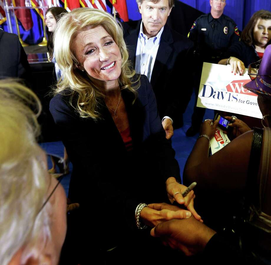 Sen. Wendy Davis, D-Fort Worth, shakes hands with a supporter after a rally Thursday, Oct. 3, 2013, in Haltom City, Texas.  Davis formally announced her campaign to run for Texas governor (AP Photo/LM Otero) Photo: LM Otero, Associated Press / AP