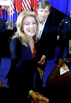 Sen. Wendy Davis, D-Fort Worth, shakes hands with a supporter at a rally Thursday, Oct. 3, 2013, in Haltom City, Texas.  Davis formally announced her campaign to run for Texas governor (AP Photo/LM Otero) Photo: LM Otero, Associated Press / AP