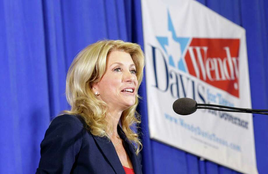 Sen. Wendy Davis, D-Fort Worth, speaks to supporters at a rally Thursday, Oct. 3, 2013, in Haltom City, Texas.  Davis formally announced her campaign to run for Texas governor. (AP Photo/LM Otero) Photo: LM Otero, Associated Press / AP