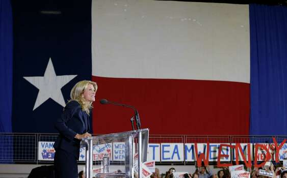 Sen. Wendy Davis, D-Fort Worth, speaks to supporter at a rally Thursday, Oct. 3, 2013, in Haltom City, Texas.  Davis formally announced her campaign to run for Texas governor. (AP Photo/LM Otero) Photo: LM Otero, Associated Press / AP