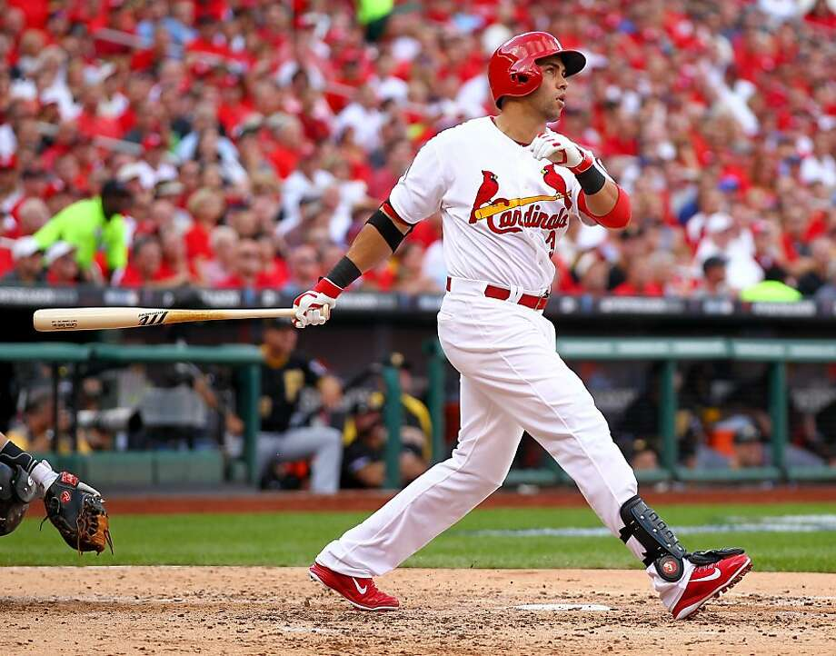 Carlos Beltran's three-run home run in the third inning, his 15th in postseason play, ignites the Cardinals' rally to a 7-0 lead en route to a 9-1 victory over the Pirates in their NLDS opener in St. Louis. Photo: Dilip Vishwanat, Getty Images