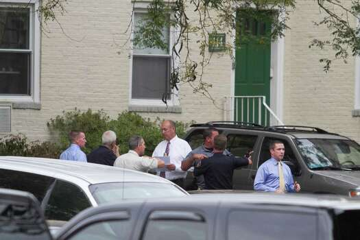 Local and federal authorities search a condominium at 114 Woodside Green in Stamford, Conn. related to a woman's attempt to ram the White House gate today in Washington, D.C. Photo: Chris Preovolos / Stamford Advocate