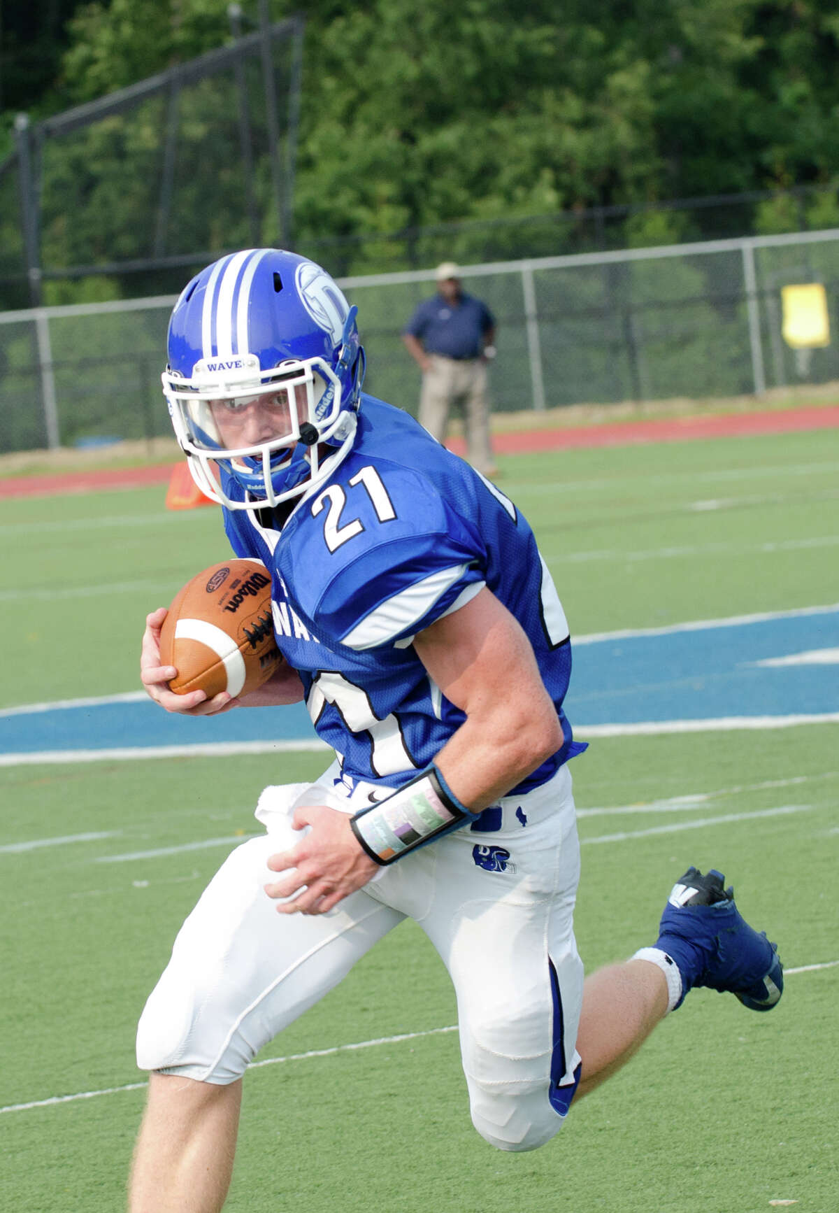 Darien's Nicholas Lombardo (21) carries the ball during the football game against Hillhouse High School at Darien High School in Darien, Conn. on Thursday, Sept. 12, 2013.