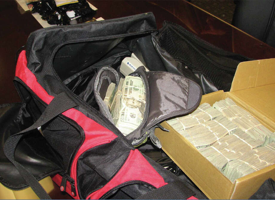Items seized during the Secret Service investigation into a credit card skimming ring, pictured in a Justice Department photo.