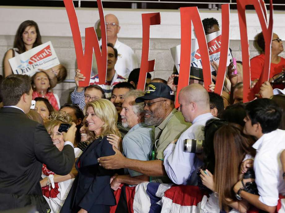 Sen. Wendy Davis, D-Fort Worth, poses for photos with supporters after a rally Thursday, Oct. 3, 2013, in Haltom City, Texas.  Davis formally announced her campaign to run for Texas governor. (AP Photo/LM Otero) Photo: LM Otero, Associated Press / AP