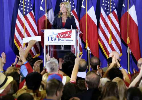 Her supporters cheer as Senator Wendy Davis announces her candidacy for Texas Governor at W.G. Thomas Coliseum in Haltom City, TX, Oct. 3, 2013. Photo: Bob Owen, San Antonio Express-News / ©2013 San Antonio Express-News