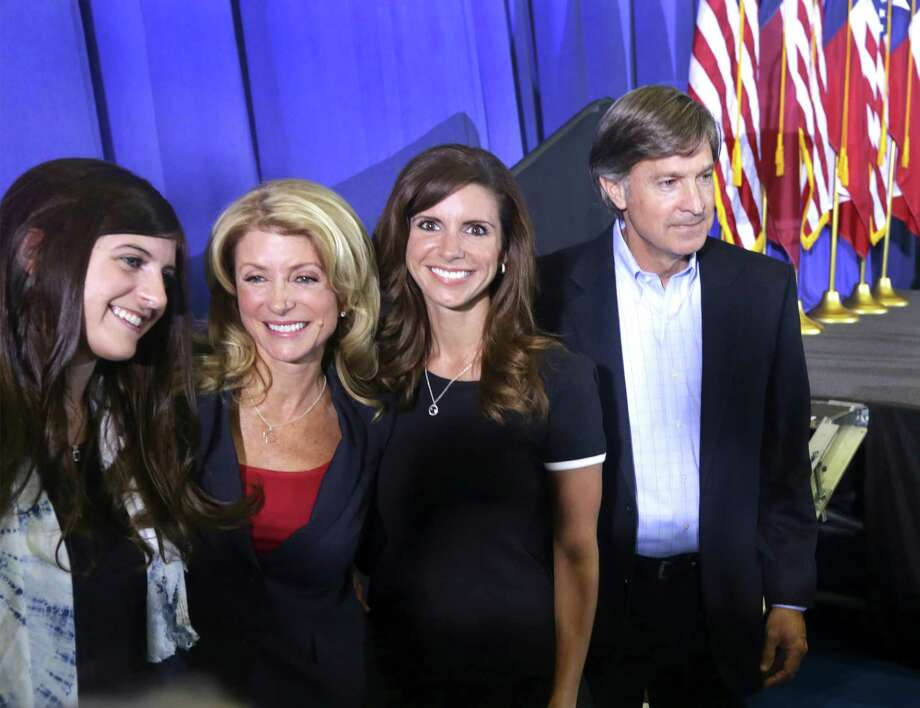 Senator Wendy Davis, center left, with her daughters Dru Davis, left, and Amber Davis, with Wendy's friend Will Wynn, former Mayor of Austin, after she announced her candidacy for Texas Governor at W.G. Thomas Coliseum in Haltom City, TX, Oct. 3, 2013. Photo: Bob Owen, San Antonio Express-News / ©2013 San Antonio Express-News