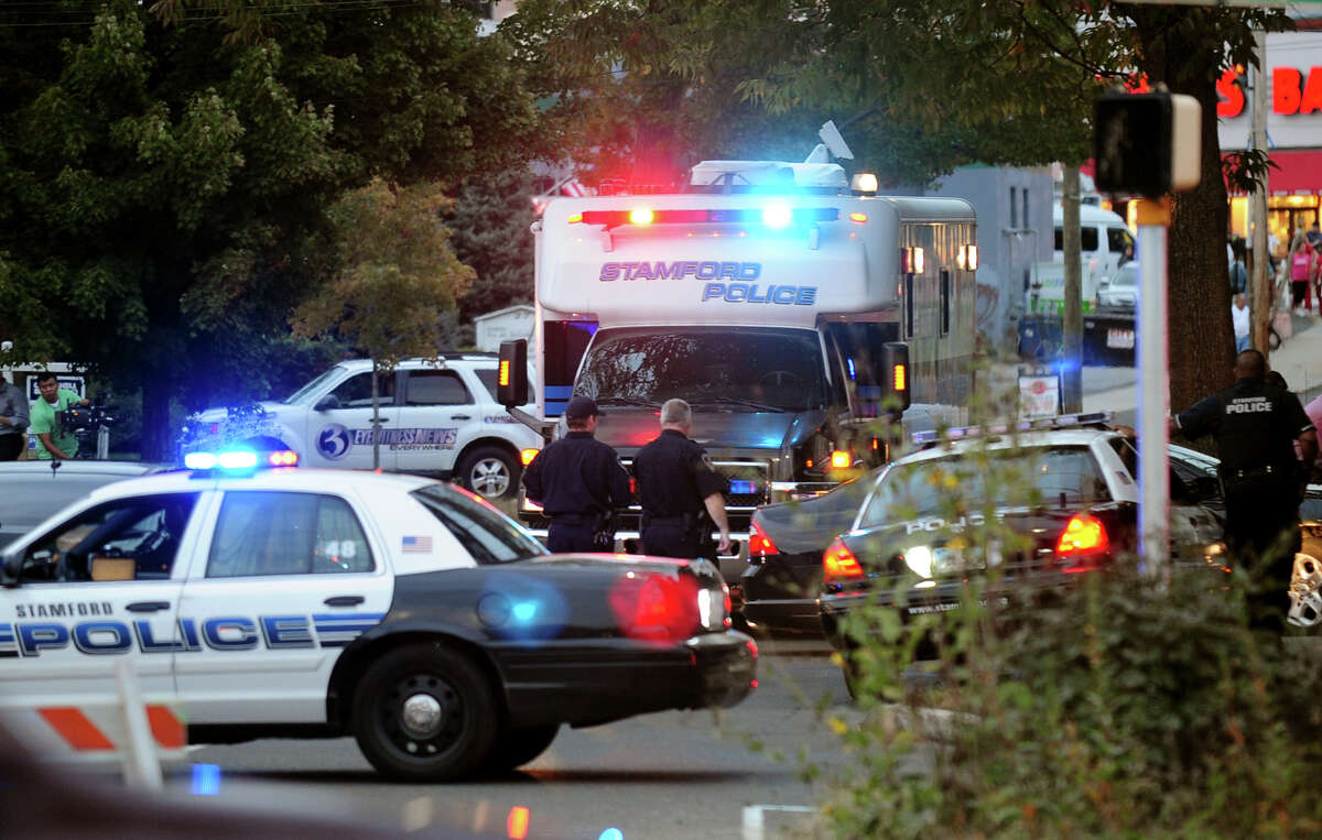 Law enforcement from local, state and federal jurisdictions are out in force at the Woodside Green Condominiums on Summer Street in Stamford, Conn. on Thursday October 3, 2013. A woman who was killed by Washington DC police earlier in the day lived in one of the condos.