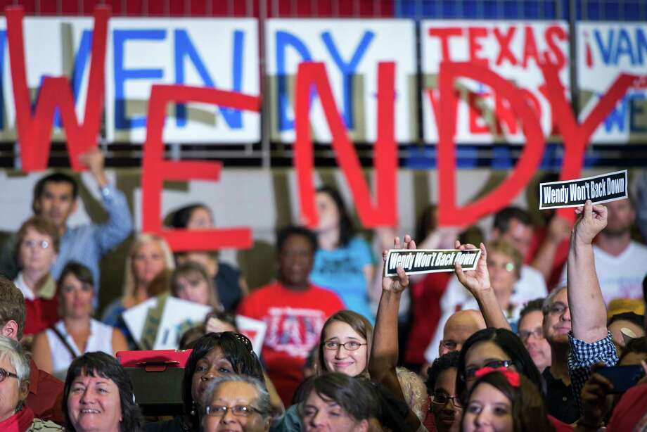Supporters hold up signs as Wendy Davis announces her candidacy for Texas governor at Wiley G. Thomas Coliseum in Haltom City on Thursday, October 3, 2013. Photo: Smiley N. Pool, Houston Chronicle / © 2013  Houston Chronicle