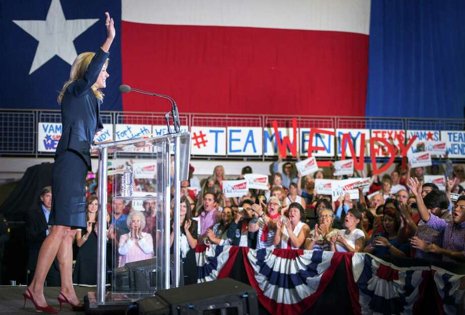 State Sen. Wendy Davis waves to supporters after announcing her candidacy for Texas governor at Wiley G. Thomas Coliseum in Haltom City on Thursday, October 3, 2013. Photo: Smiley N. Pool, Houston Chronicle / © 2013  Houston Chronicle