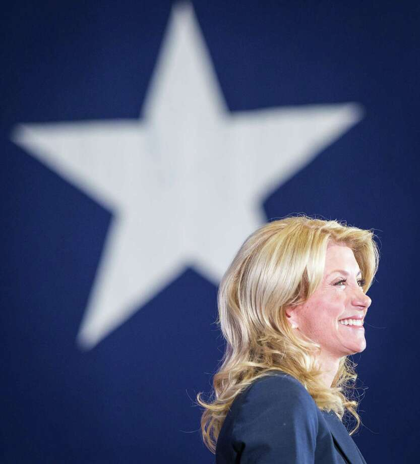 State Sen. Wendy Davis smiles as she announces her candidacy for Texas governor at Wiley G. Thomas Coliseum in Haltom City on Thursday, October 3, 2013. Photo: Smiley N. Pool, Houston Chronicle / © 2013  Houston Chronicle