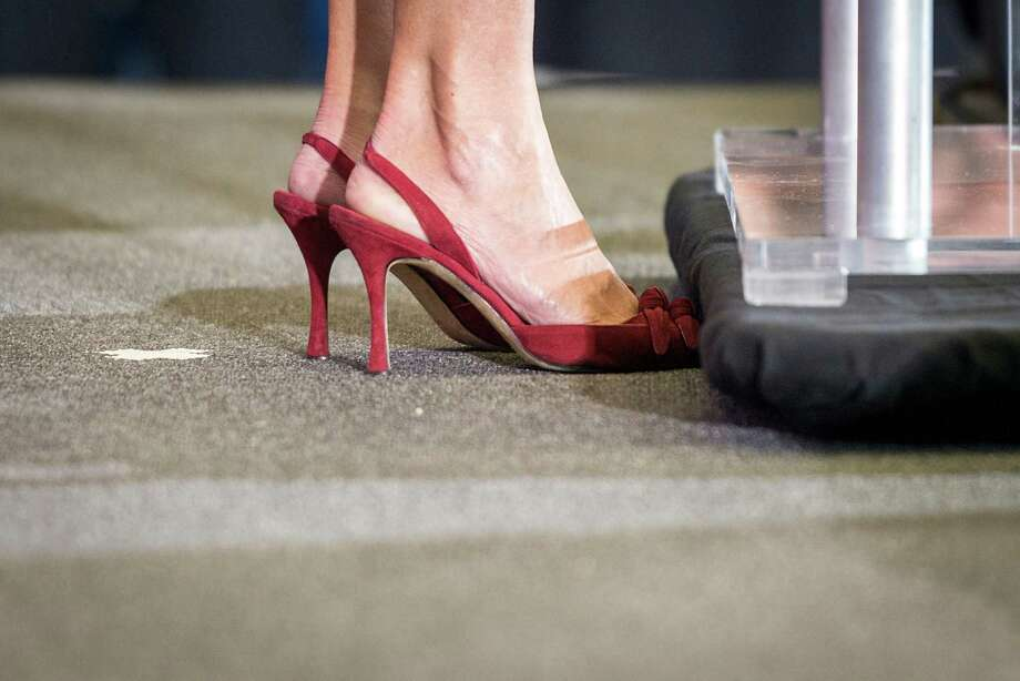 State Sen. Wendy Davis made pink running shoes famous during her filibuster, but she wears heels as she announces her candidacy for Texas governor at Wiley G. Thomas Coliseum in Haltom City on Thursday, October 3, 2013. Photo: Smiley N. Pool, Houston Chronicle / © 2013  Houston Chronicle