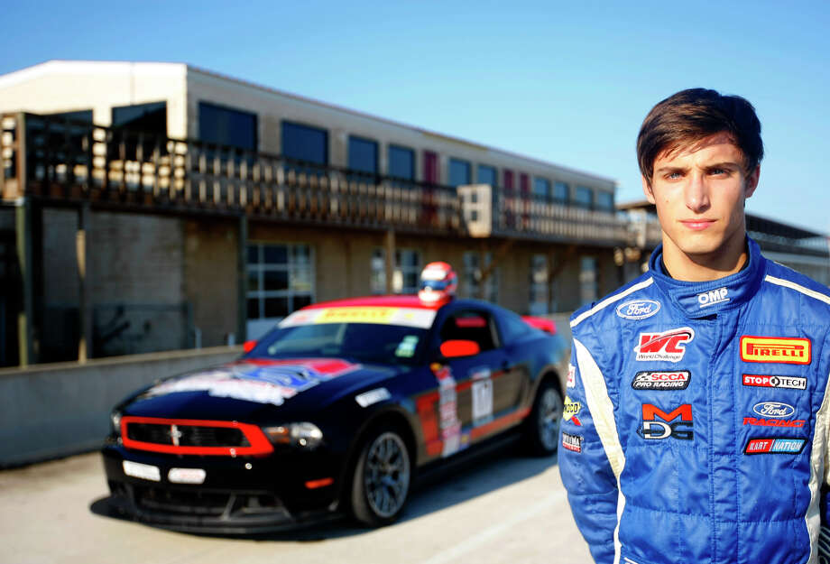 Pirelli World Challenge driver Alec Udell stands beside his Ford Mustang Boss 302 at the MSR Houston Raceway track Thursday, Oct. 3, 2013, in Angleton. The 17-year-old, high school senior will race in the Shell and Pennzoil Grand Prix of Houston, which starts Friday. (Cody Duty / Houston Chronicle) Photo: Cody Duty, Staff / © 2013 Houston Chronicle