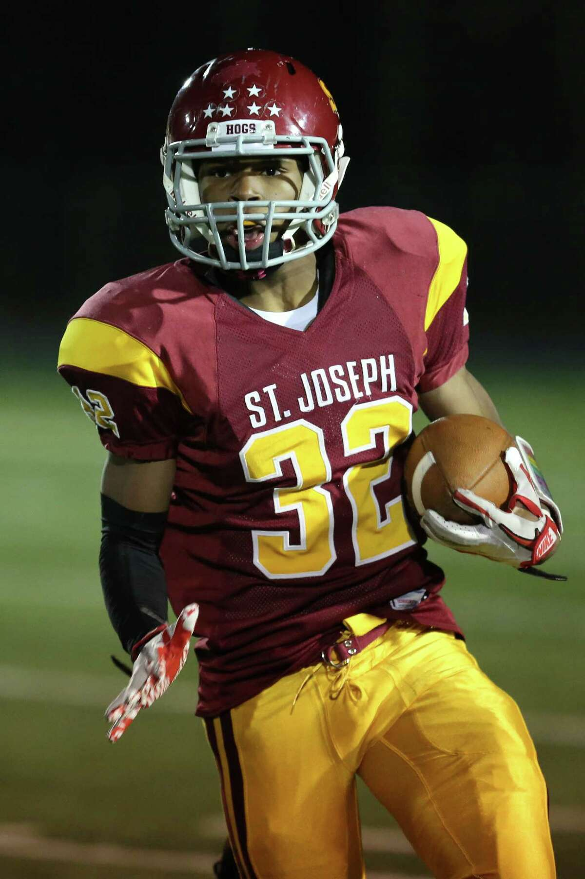 Mike Ross Connecticut Post freelance -St. Joseph's #32 Mufasa Abdul-Basir moves the ball downfield against Trinity Catholic High School during first half action on Thursday evening.