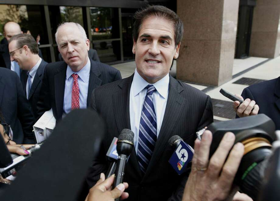 Mark Cuban, billionaire owner of the Dallas Mavericks basketball team, exits federal court in Dallas, the site of his insider-trading trial in which SEC attorneys painted him as a win-at-all-costs businessman. Photo: Bloomberg