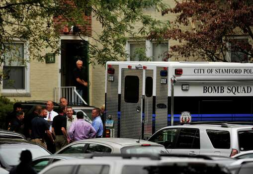 Law enforcement officials and the City of Stamford Bomb Squad descend on Woodside Green Condominiums on Summer Street in Stamford, Conn. as part of the investigation into the shooting in Washington, DC earlier today, Thursday, Oct. 3, 2013. Photo: Jason Rearick / Stamford Advocate