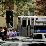 Law enforcement officials and the City of Stamford Bomb Squad descend on Woodside Green Condominiums on Summer Street in Stamford, Conn. as part of the investigation into the shooting in Washington, DC earlier today, Thursday, Oct. 3, 2013.