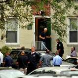 Law enforcement officials descend Woodside Green Condominiums on Summer Street in Stamford, Conn. as part of the investigation into the shooting in Washington, DC earlier today, Thursday, Oct. 3, 2013.