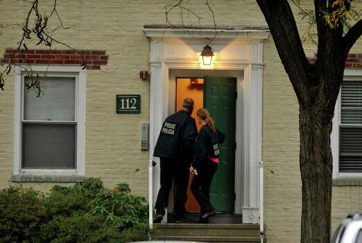 Law enforcement officials descend Woodside Green Condominiums on Summer Street in Stamford, Conn. as part of the investigation into the shooting in Washington, DC earlier today, Thursday, Oct. 3, 2013. Photo: Jason Rearick / Stamford Advocate